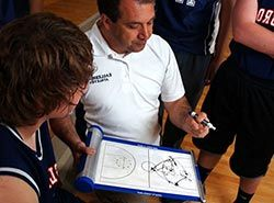 Collaborate with professional Spanish trainers on basketball camp in Barcelonas