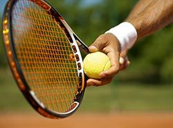 Collaborate with professional Spanish trainers on tennis camp in Barcelonas
